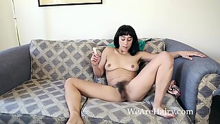 Violet Russo undresses nude on her sofa