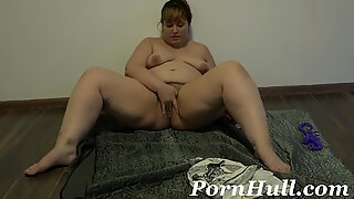 pushes a pear out of a hairy beaver and wanks, mature fabulous BBW