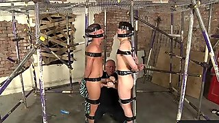 Twinks tied to a scaffolding get their dick used and emptied