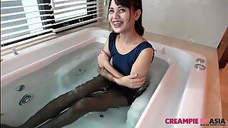 Pantyhose in bathtub with skinny Thai girl creampie