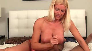 Handjob loving milf stroking dick in bedroom