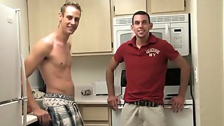 Sexy strong guys meet on kitchen