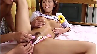 Cute Oriental girl brought to orgasm by two guys