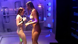 Lesbian pornstars licking their cunts in a club