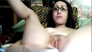 Brunette girl with glasses fucks her pussy deep with sex toy