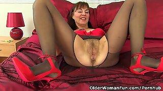 brit grannie Georgie drills a dildo