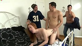 Busty nerdy redhead gets pounded doggy while jerking off two dicks