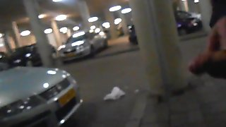 Cum in the centre of a parkinglot in full light