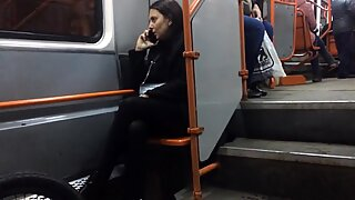 Hot MILF in black pantyhose in late tram