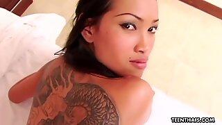 Thai slut with tattoos doggystyle fucking