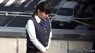 Asian lady pisses herself