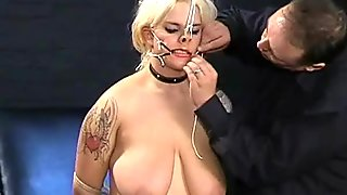 Busty amateur BDSM slave Cherrys nose hook bondage