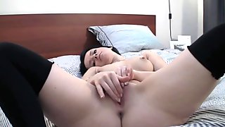 Petite brunette Britney is finger banging her tiny pussy