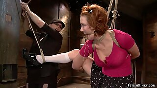 Redhead lesbian is caned on hogtie