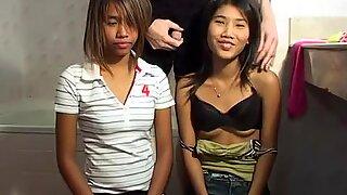 Thai teens lick cock in bathroom