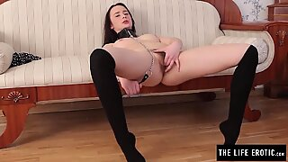 Girl in stockings masturbates her hairy pussy with a chain